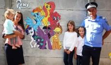 Surpriză colorată! Un jandarm din Târgoviște a pictat pereții unei grădinițe