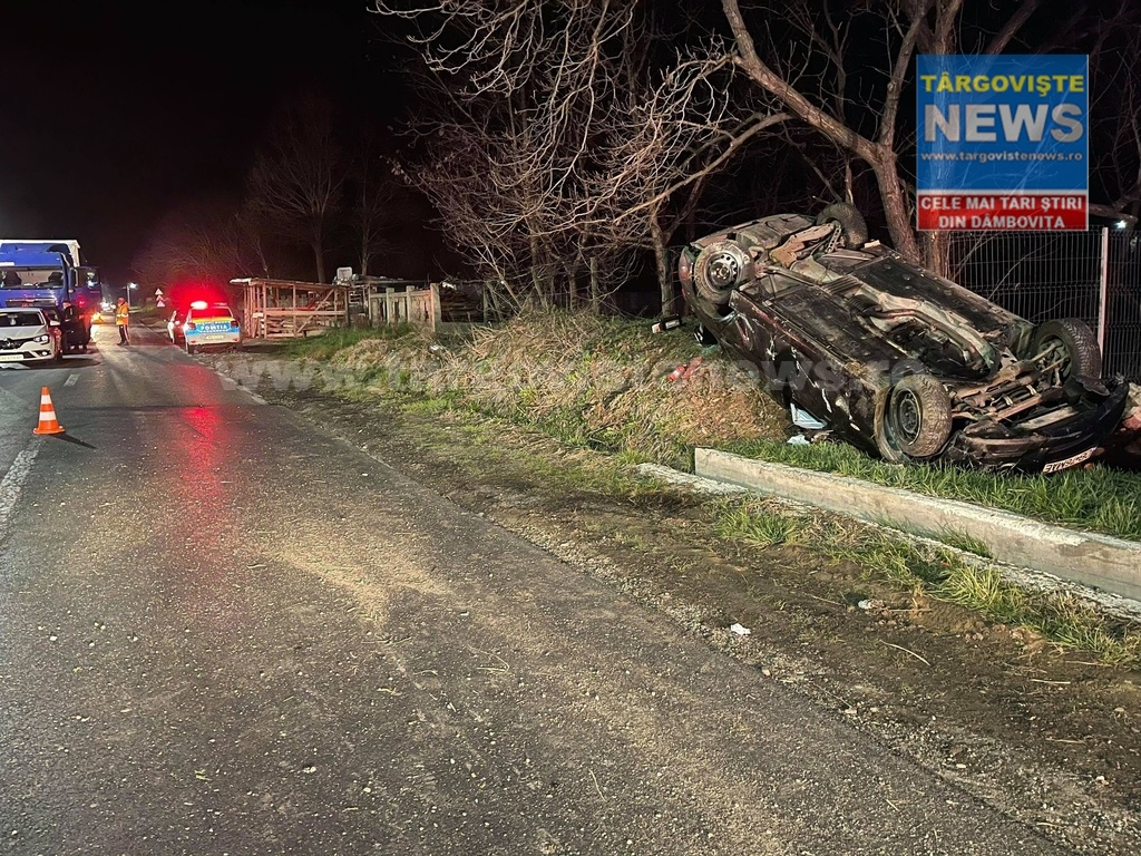 Accident grav la Gheboieni. O şoferiţă s-a răsturnat cu BMW-ul şi s-a oprit într-un gard